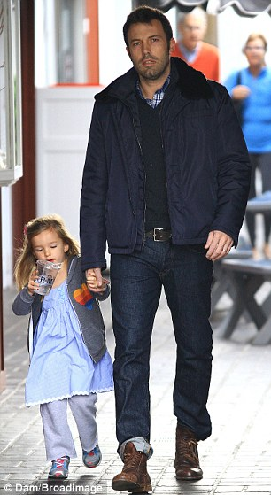 Daddy on call: Ben Affleck is back at home in Los Angeles while Jennifer Garner shoots scenes in New Orleans. Pictured with his three-year-old Seraphina at the Brentwood Country Mart on Thrusday