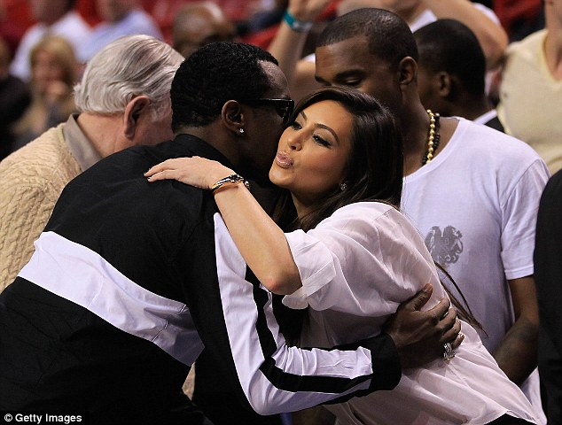 Air kissing away: Kim unleashed the most showbiz smacker on Diddy
