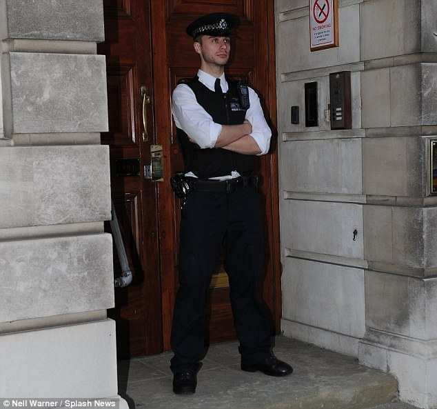 Guard: An officer guards the entrance to the block where the nurse's body was found