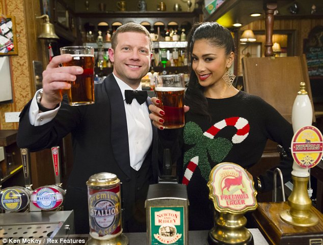 Wrong set: Nicole Scherzinger and Dermot O'Leary pay a visit to the Rovers Return as they prepare for the X Factor final in Manchester