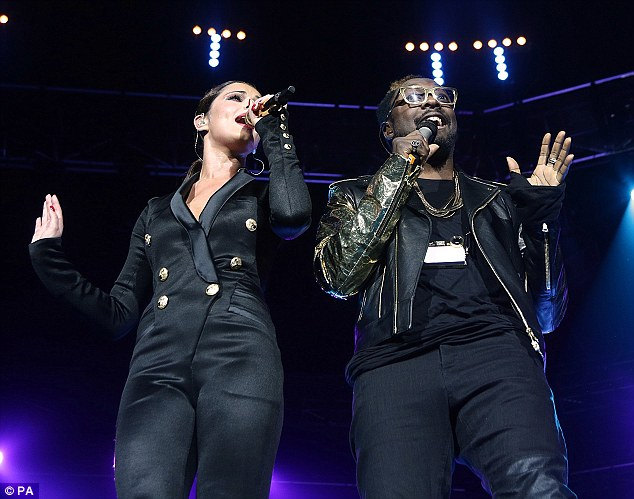 Having a blast at the Jingle Bell Ball: Cheryl was joined on stage by her manager Will.I.Am