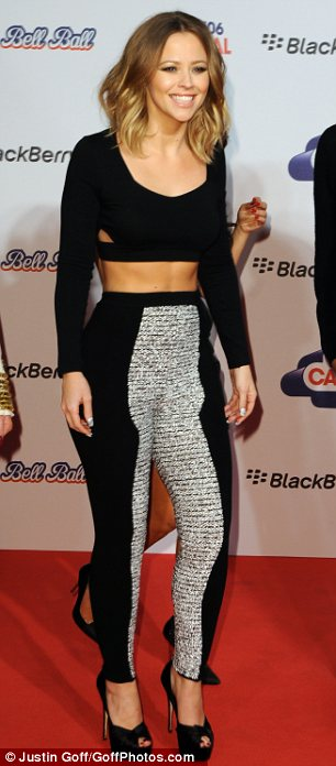 Abs-olutely fabulous: Kimberley showed off her washboard stomach in a cropped top and a pair of high-waisted trousers