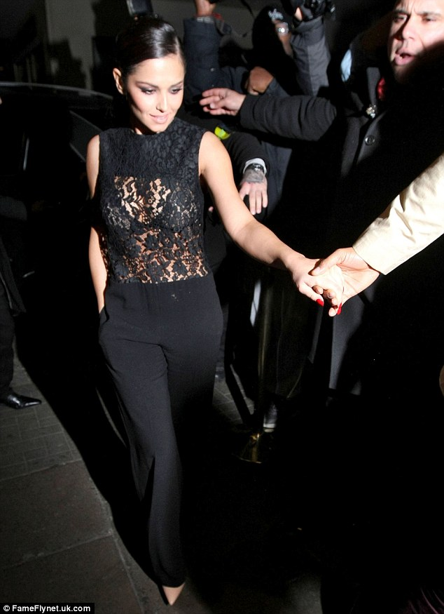 See through: Cheryl Cole looked superb in a sheer black lace top on Sunday morning as she stepped out at the Rose Club