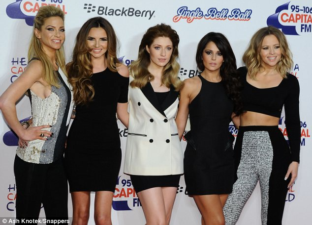 Dressed to impress: The band all wore monochrome colours for their appearance at the 02 arena in Greenwich