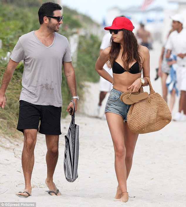 Pals: Joined by a male friend, Irina was this time not joined by her famous footballer beau Cristiano Ronaldo