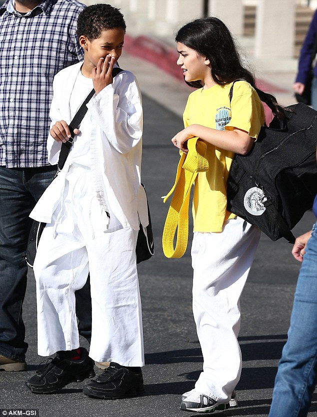 Level two: The long-haired youngster was even wearing a t-shirt bearing the school's name, which matched his yellow belt - the second level (called Kyu) of achievement in Gozen Karate