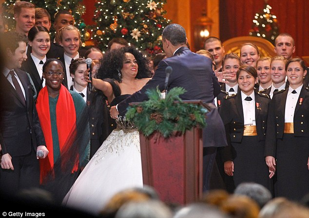 Fond embrace: The star hugged the President after her song