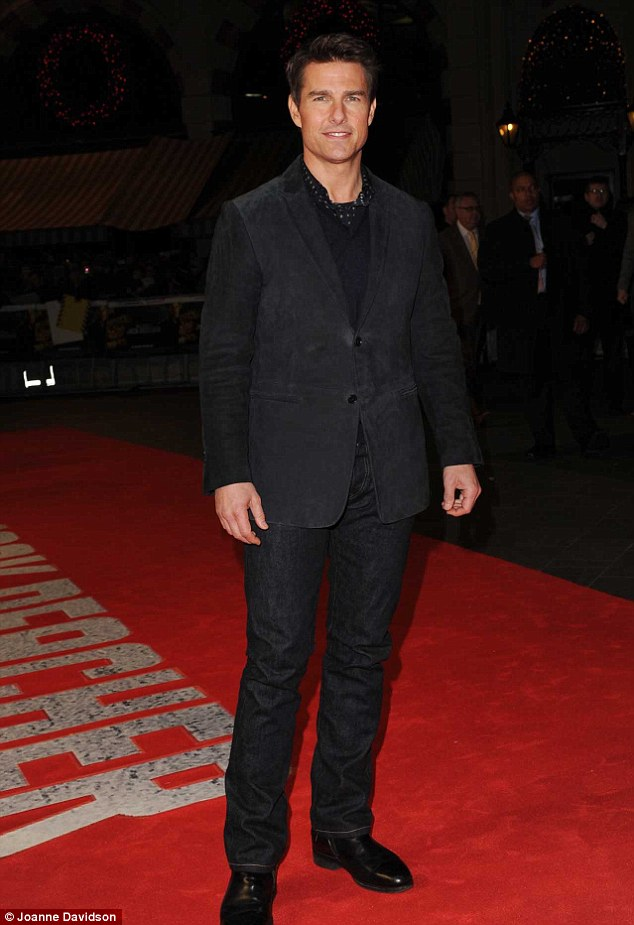 Action hero: Tom Cruise looks casual as he shows up to promote his latest action flick