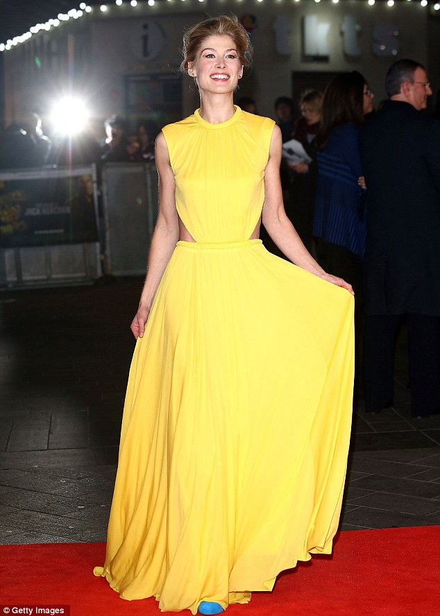 Ray of light: The British actress doesn't seem to feel the cold as she poses for photographs on the red carpet