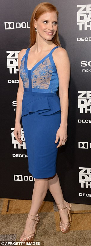 Stunningly simple: Jessica kept her accessories to a minimum and hair style simple on the Hollywood red carpet on Monday