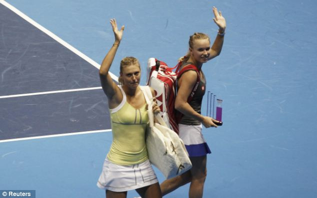 Game over: Maria Sharapova, left, of Russia and Caroline Wozniacki of Denmark wave to their supporters after their match in an exhibition tour in Sao Paulo