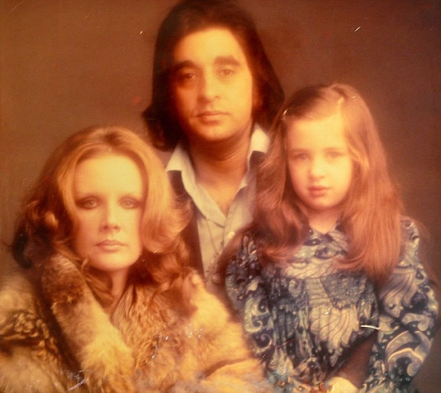 Tanith as a six year old with her parents. She said at the age of 13, she changed her name from Mukerjee to her mother's name of Carey