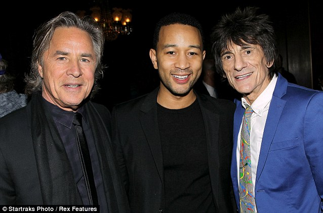 Rock star additions: John Legend and the Rolling Stones Ronnie Wood were also at the screening, posing with Johnson