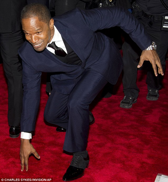 Larking around: Foxx looked in good spirits as he played up to the cameras on the red carpet