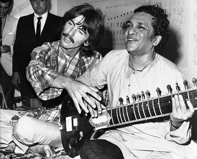 Eye Opening: George Harrison, of the Beatles, sits cross-legged with his musical mentor, Ravi Shankar of India, in Los Angeles in 1967