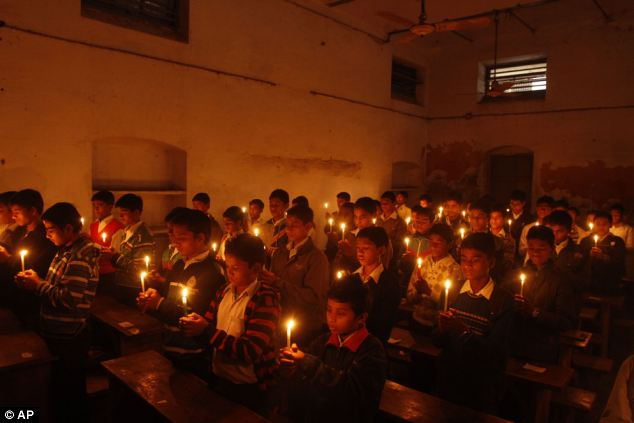 Tribute: Indian students light candles to pay tribute to Ravi Shankar