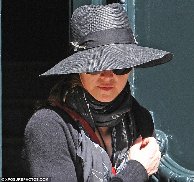 Going incognito: On Tuesday, Madonna came over all bashful as she hit beneath dark shades and a wide-brimmed hat in Buenos Aires, Argentina