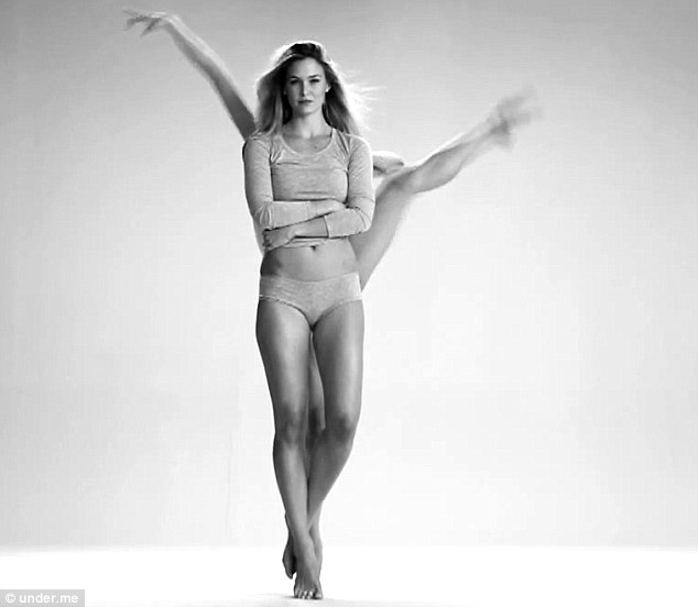 What a body: In another video, Bar shows off her underwear while dancers pirouette across the screen