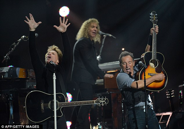 Hands up! Jon Bon Jovi got the crowd going while Springsteen jammed out on guitar