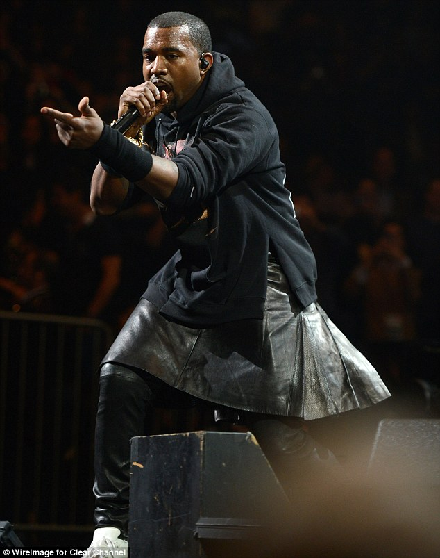 Making a statement: Kanye West defied fashion critics, wearing a leather skirt over his pants