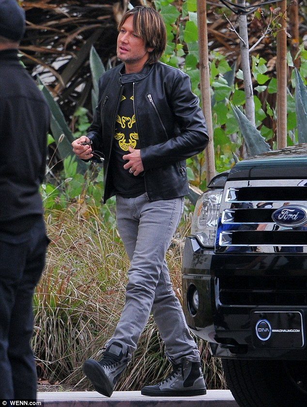 Cool customer: Keith Urban looked cool as a cucumber in jeans and a leather jacket