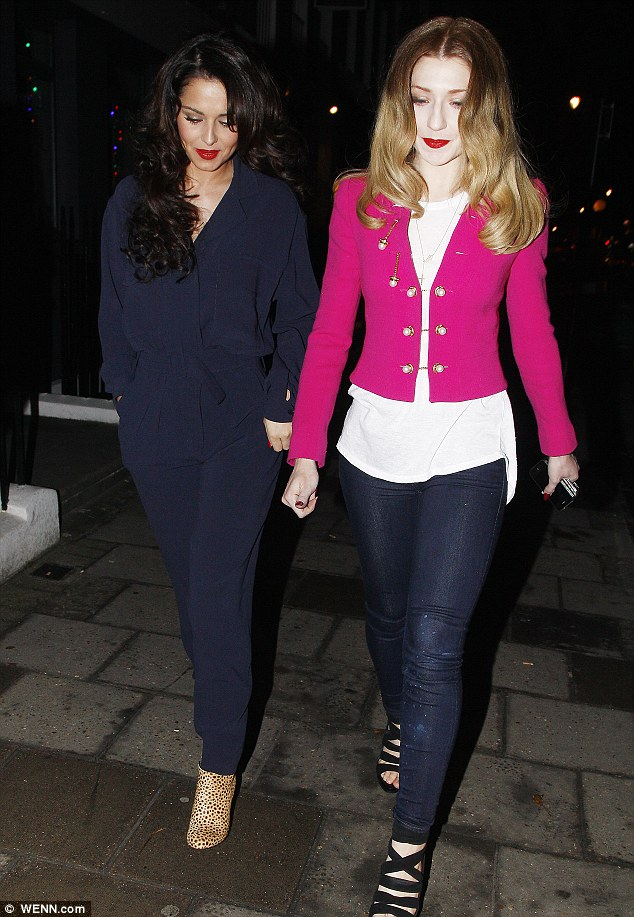 Heads down: Two of the five Girls Aloud members look slightly secretive as they leave the restaurant for their dinner