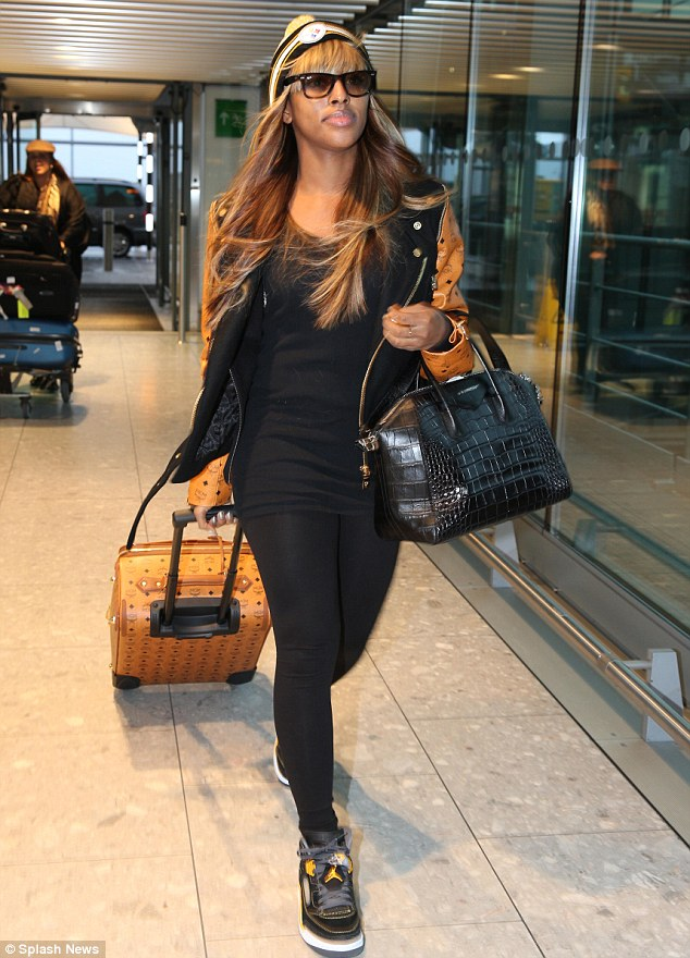 Talk about matchy-matchy! Alexandra Burke shows off her superstar style credential as she matches her bag with her jacket