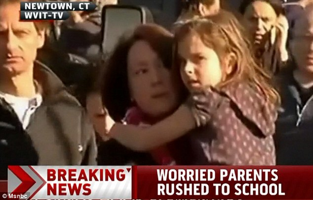 Frantic parents rushed to the school to be reunited with their children