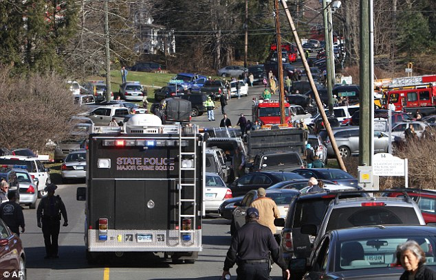 Emergency personnel, parents and teachers swarmed to Sandy Hook Elementary School after the gunman opened fire