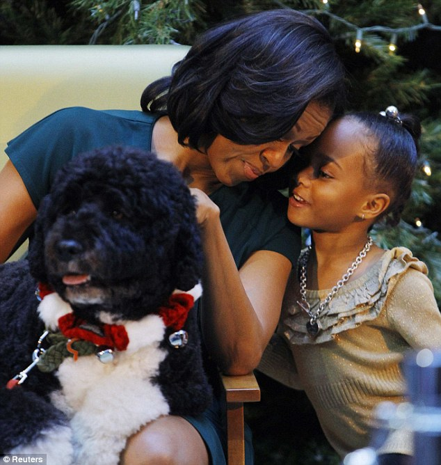 Precious moment: First Lady Michelle Obama read 'The Night Before Christmas' to young children on Friday at the same time as the horrific Connecticut shooting
