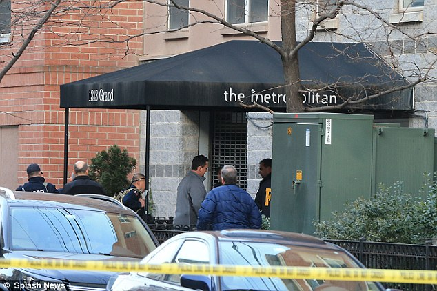 Search: Police enter the apartment building in Hoboken, New Jersey where accused Ryan Lanza lives