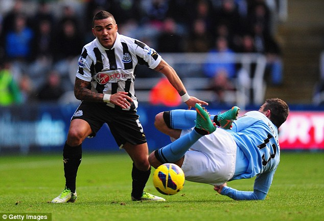 Battling through: Danny, 25, challenged Manchester City player Aleksander Kolarov (R) during the Barclays Premier League match