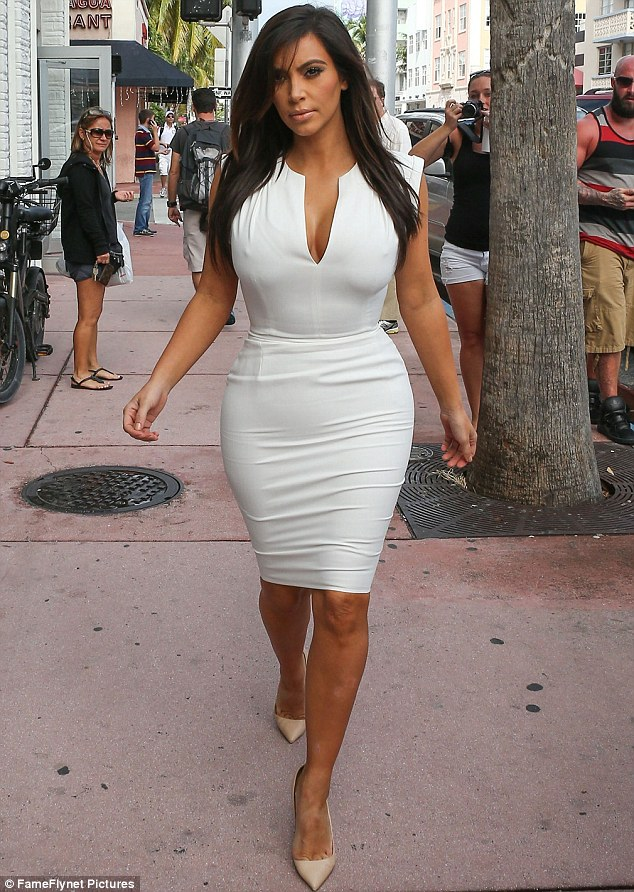 Centre of attention: Kim hit the shops in Miami and drew lots of curious stares from admirers and fans