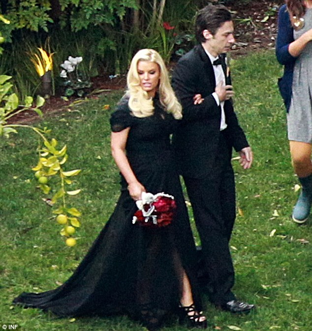 Wedding belle: Jessica wore a long black gown with a train and black strappy wedges as Zach Braff escorted her at the wedding