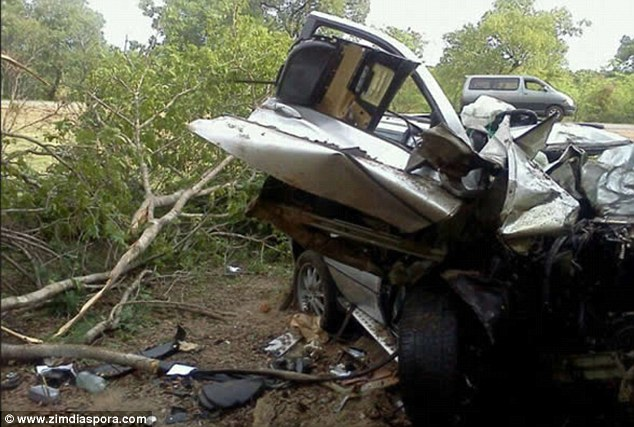 Horror: The smashed-up BMW X5 on the side of the road that was reportedly driven by Adam Ndlovu