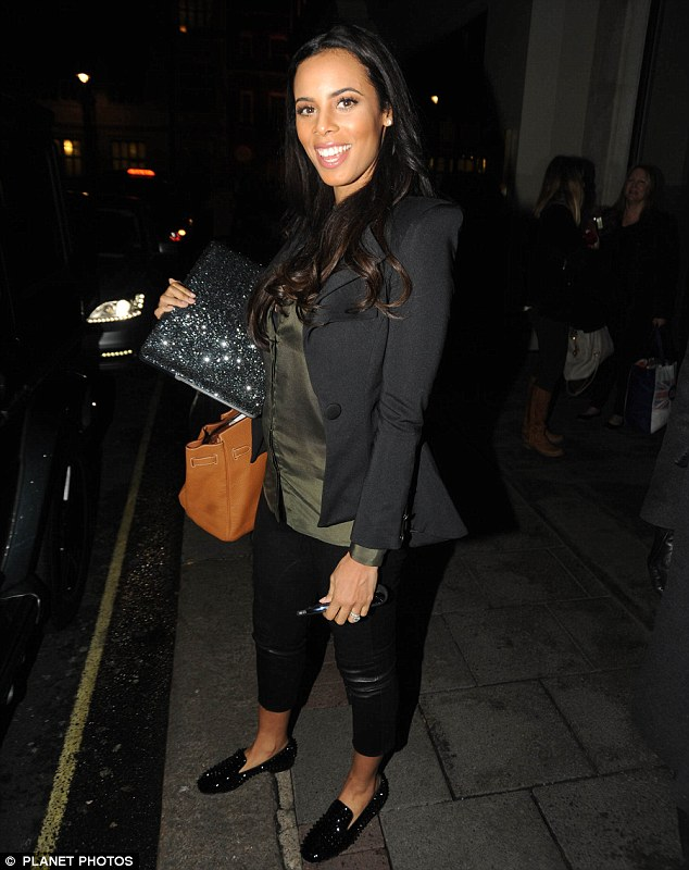 Starting to show: Pregnant Rochelle Humes was all smiles as she left her Mayfair hotel on Saturday evening