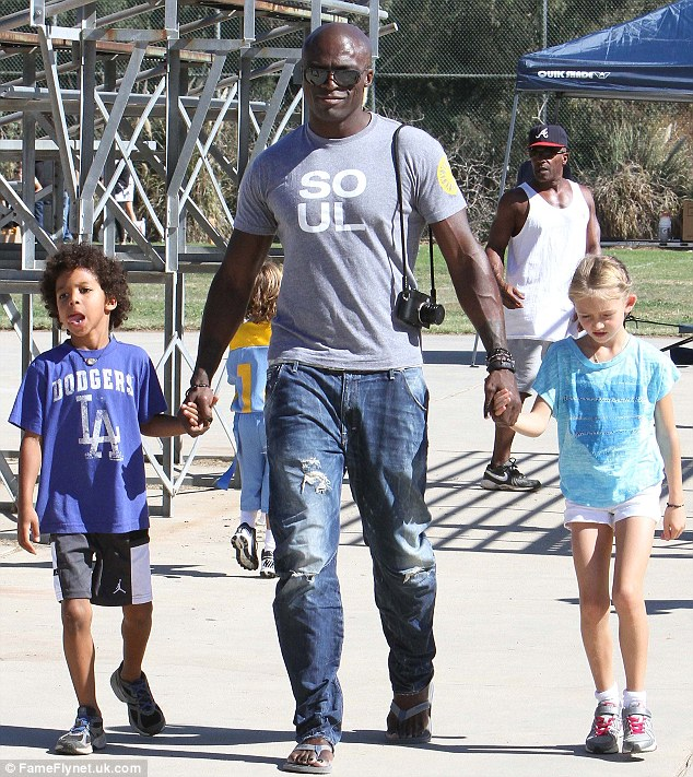 Not impressed: Ex Seal, pictured here with two of his children in California in October, was not happy when he found out Heidi had moved on