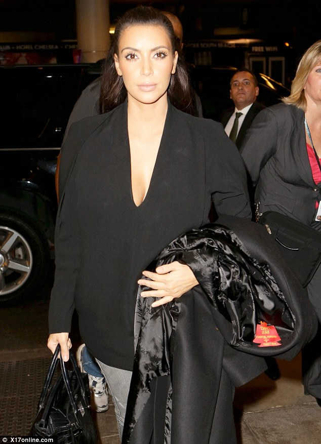 She'll need that coat: Kim was heading off to New York
