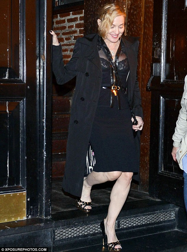 Demure... done the Madonna way! The singer opted for a black pencil skirt teamed with a sheer shirt as she enjoyed date night with boyfriend Brahim Zaibat in Buenoes Aires on Sunday night