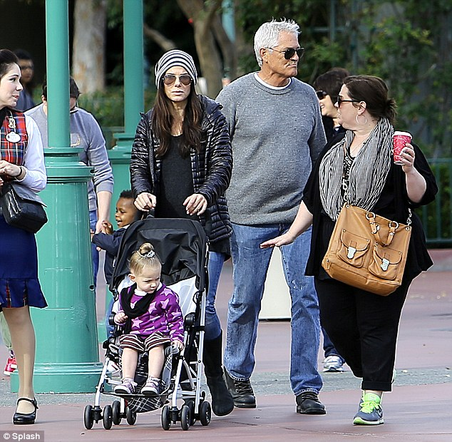 Happiest place on Earth: Sandra Bullock and Melissa McCarthy returned to the Disneyland in Anaheim Sunday for more family fun after their Thursday outing together
