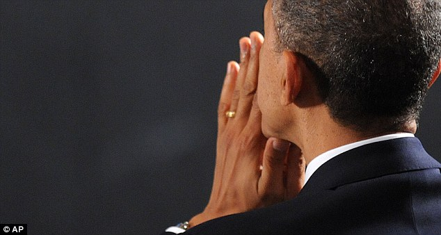 President Barack Obama reflects during an interfaith vigil for families of the victims as well as families from Sandy Hook Elementary School
