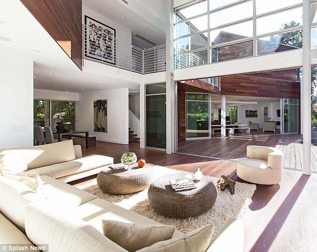 A room with a view: The house has floor-to-ceiling windows and boasts spectacular views