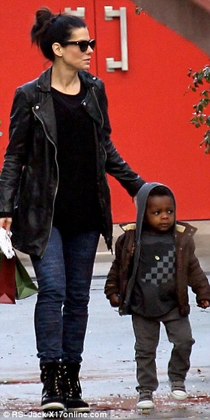 Hollywood doppelgangers: January Jones and Sandra Bullock looked like twins in their almost identical outfits as they spent time with their sons in different parts of Hollywood on Monday