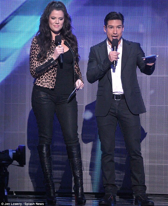 Hosts with the most: Khloe later joined co-host Mario Lopez on stage and towered above him in her lace up boots