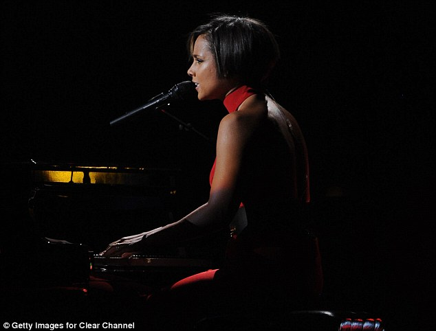 Lady in red: Alicia sported a sleek short 'do and sexy backless number when she performed at the 12-12-12 Sandy concert in New York this week
