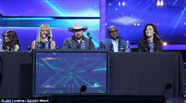 Possible winners? Carly Rose sits alongside Britney, while Tate Stevens, L.A. Reid and Demi Lovato made up the rest of the panel today