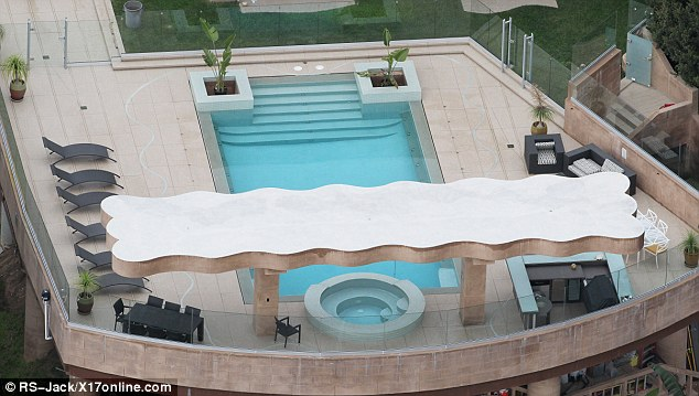 Making a splash: Rihanna has a super wide zero edge swimming pool to host shindigs at that come equipped with a poolside bbq and bar