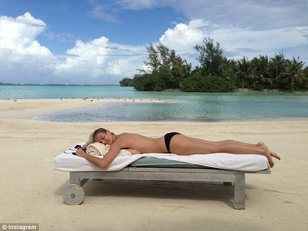 Postcard from paradise! Heidi Klum unwinds on holiday in a secret location
