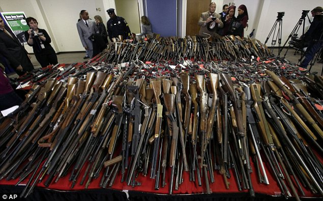 Record gun collection: Impacted by the carnage in Sandy Hook, residents of Camden, New Jersey, turned in a huge amount of weapons in a gun buyback program over the weekend