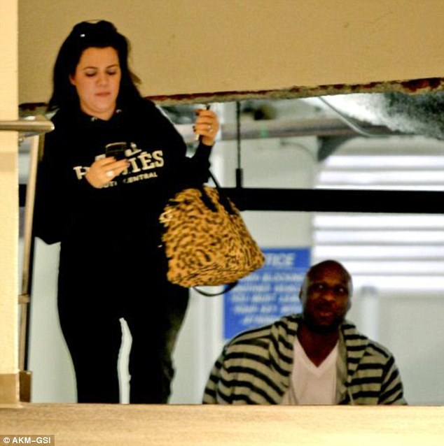 Dressed down: Make-up free Khloe was joined by her husband Lamar Odom later in the day as they visited the dentist